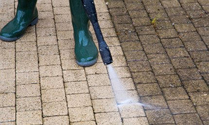 Photo of professional cleaning of a driveway